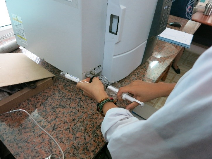 Figure 3: Preparing a Gas Sample for GHG Analysis
